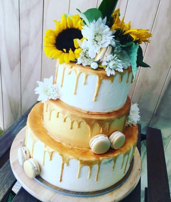 Golden-Drip-3-Tier-Flower-Cake-597x705 Custom Cakes