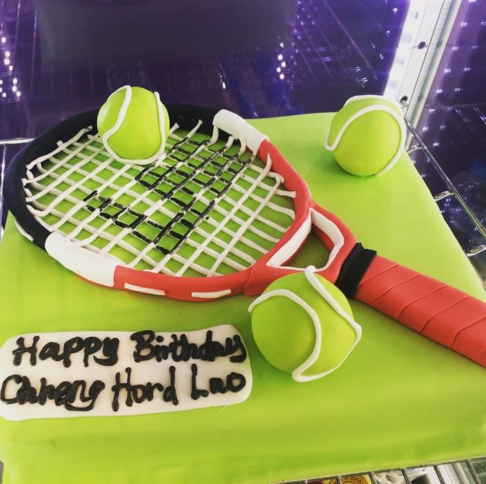Tennis-Racket-Cake-705x702 Custom Cakes